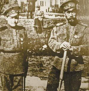 Tsarevich Alexei, Tsar Nicholas II during captivity in Tsarskoe Selo. (Possibly Grand Duchess Olga sit behind them looking on.)