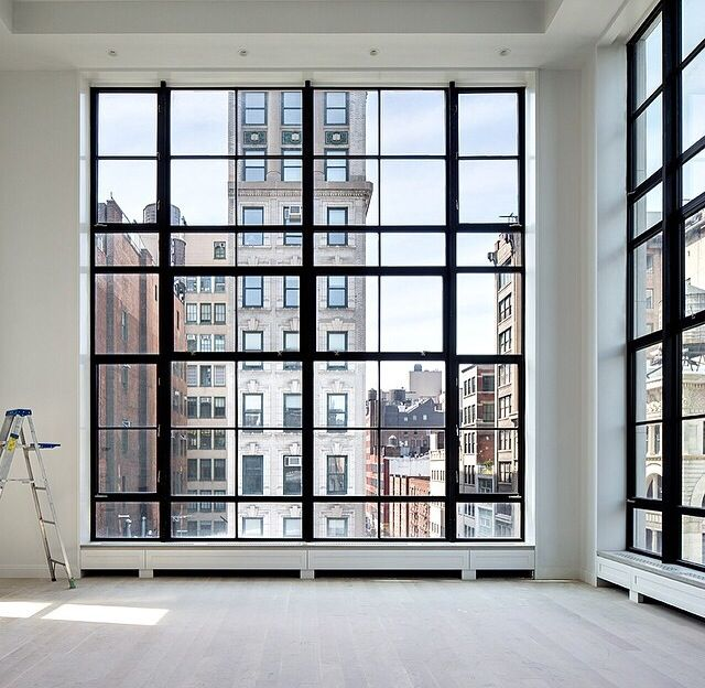 oh how i love black framed windows... even better when they're floor to ceiling. <3