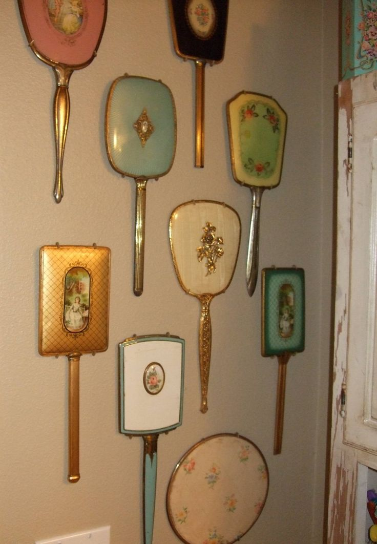 vintage mirrors as wall art—not sure if I like this many, but a couple would be nice! I love the blue, cream, and green ones in the center.