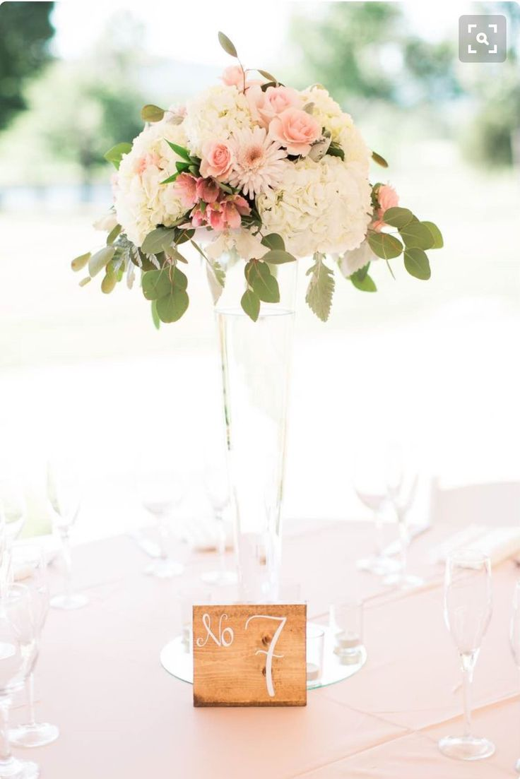 Nilson Wedding - 6 centerpieces like this.  Tall Pilsner vase  With accent of soft pink, white roses, and some blush accent too. Also gold curly willow accent on top.  I will provide the vases.