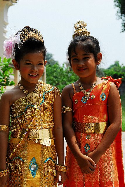 Two happy Thai children in traditional costume