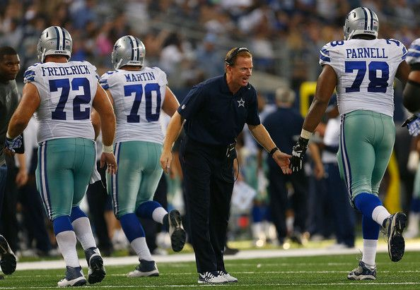 Travis Frederick Photos Photos - Head coach Jason Garrett of the Dallas Cowboys congratulates Jermey Parnell #78 of the Dallas Cowboys as he and Travis Frederick #72 of the Dallas Cowboys and Zack Martin #70 of the Dallas Cowboys come off the field after a touchdown against the New York Giants in the second half at AT&T Stadium on October 19, 2014 in Arlington, Texas. - New York Giants v Dallas Cowboys