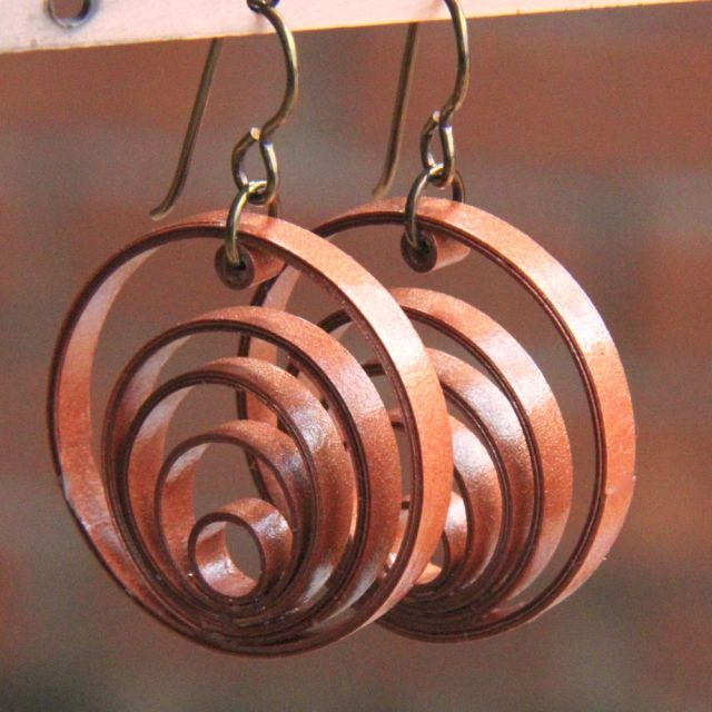 using jeweltone metallic paper for paper quilled jewelry.
