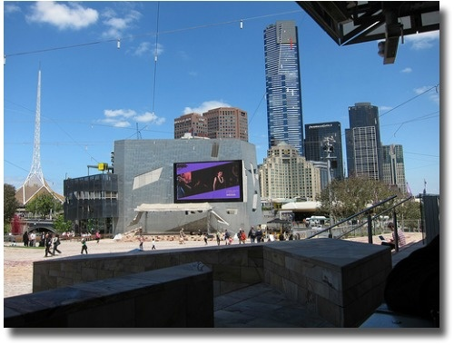 Enjoying the sun (and shade) at Federation Square.