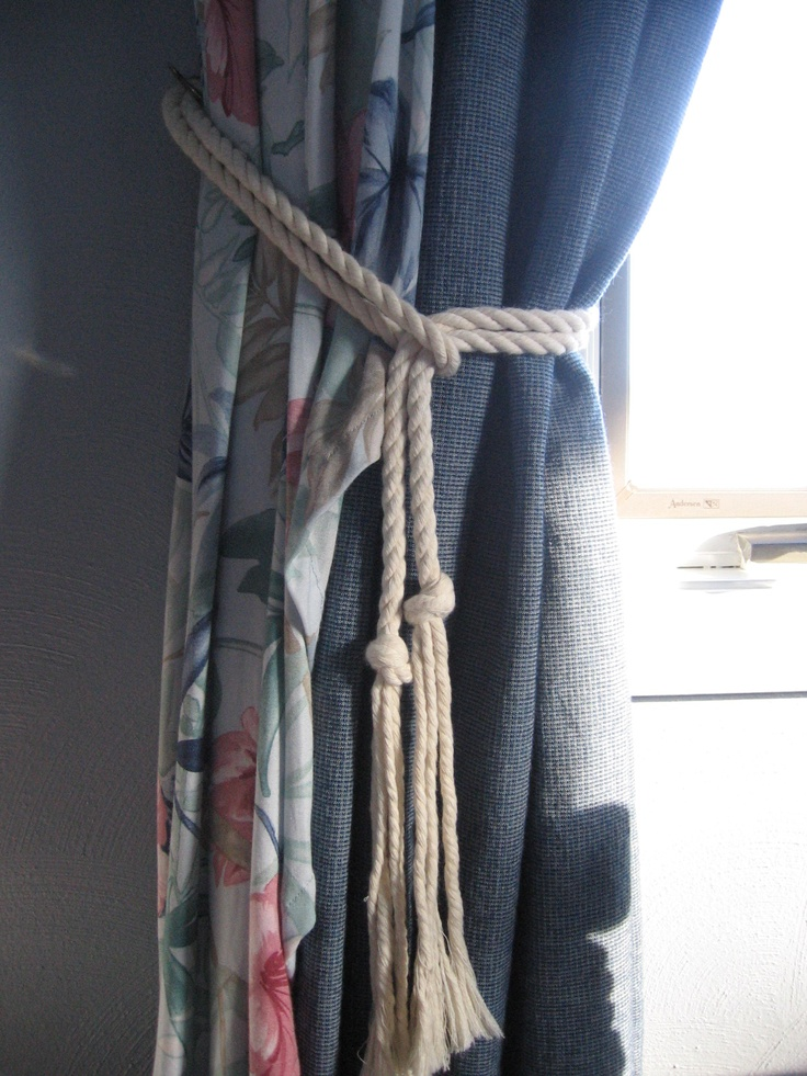 With lake living I feel the great need to have a nautical touch in each room.  I replaced the normal fabric tie-back with rope...for the nautical touch