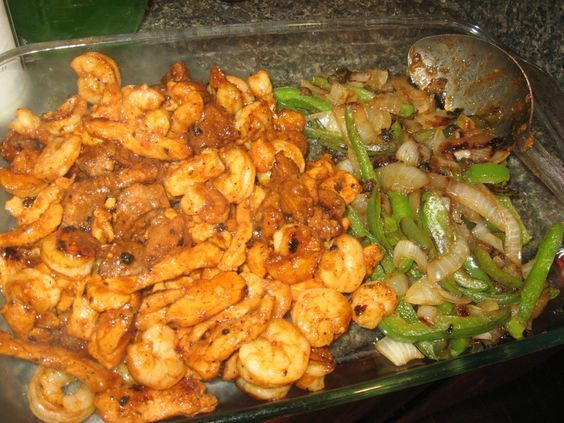 This is a wonderful recipe for fajitas! It includes chicken, beefsteak, pork, and shrimp. A great marinade and a recipe for fajita seasoning are included, along with photos.