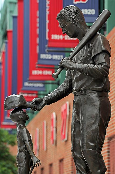 Bronze tribute to Ted Williams outside Boston Fenway Park. The statue of this larger than life figure inside Fenway Park is located outside of Gate B at Fenway Park on Van Ness Street.