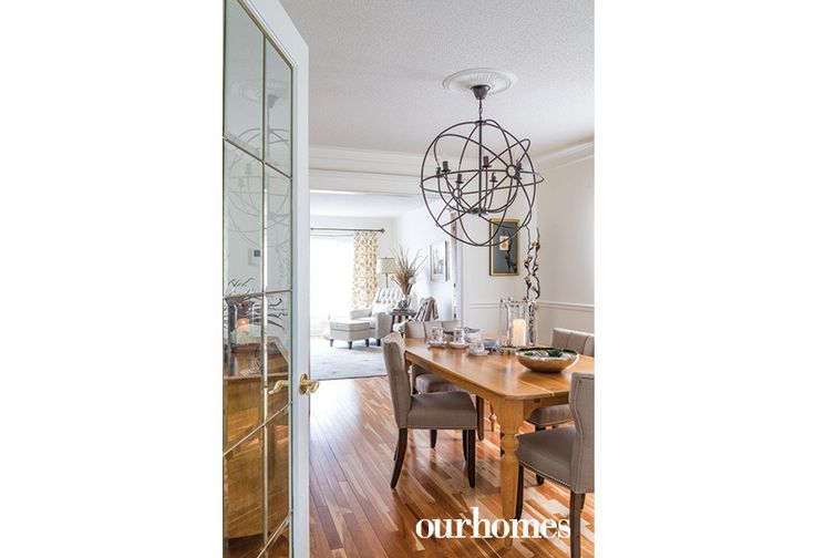 The cherry hardwood floors stayed in a newly designed grey and cream palette. A spectacular iron-orb chandelier transforms the dining room.  http://www.ourhomes.ca/articles/build/article/from-house-to-home