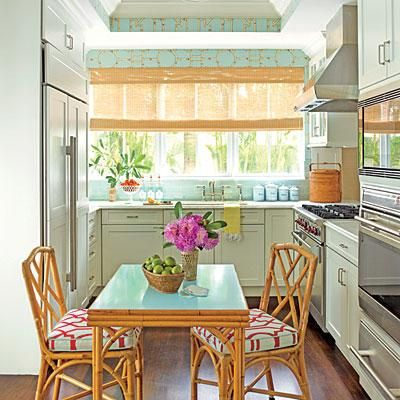 Classic and Clean | This kitchen scored a makeover with nickel hardware, marble countertops, and an icy blue tile backsplash. | SouthernLiving.com