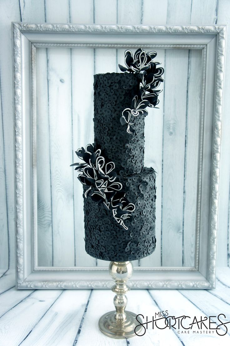 Describe the cake, details and techniques: I used black cake lace on a sequin cake lace mat to create the black edible sequins. With the fl