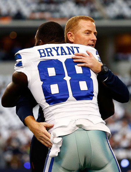 Dez Bryant and Jason Garrett Photos Photos - Head coach Jason Garrett of the Dallas Cowboys embraces Dez Bryant #88 of the Dallas Cowboys before the start of their NFC Wild Card Playoff game against the Detroit Lions at AT&T Stadium on January 4, 2015 in Arlington, Texas. - Wild Card Playoffs - Detroit Lions v Dallas Cowboys