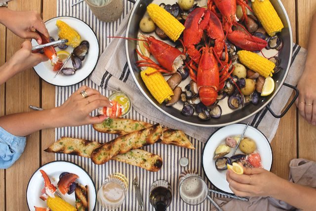 Nothingepitomizes summer more than alobster boil. It's best enjoyed outdoors and with friends excited to get their hands dirty and their bellies full.And the bestthing about a lobster boil is that it feeds so many people, but you actually spend very little time actually cooking. I made this