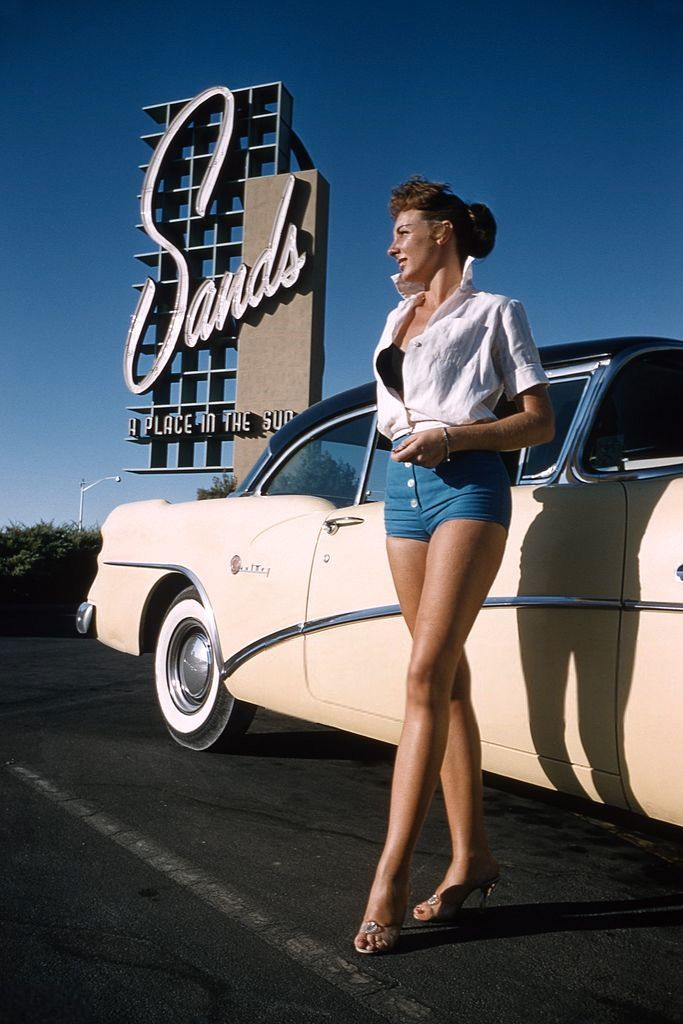 Las Vegas, 1955. A model poses next to a 1954 Buick Roadmaster outside the Sands Hotel. Photo by Hy Peskin.