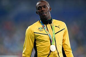 """Usain Bolt, is a Jamaican sprinter, nicknamed """"Lightning Bolt."""" . He is the first person to hold both the 100 metres and 200 metres world records since fully automatic time became mandatory. He also holds the world record as a part of the 4 × 100 metres relay. He is the reigning world and Olympic champion in these three events. Due to his unprecedented dominance and achievements in sprint competition, he is widely considered to be the greatest sprinter of all time."""