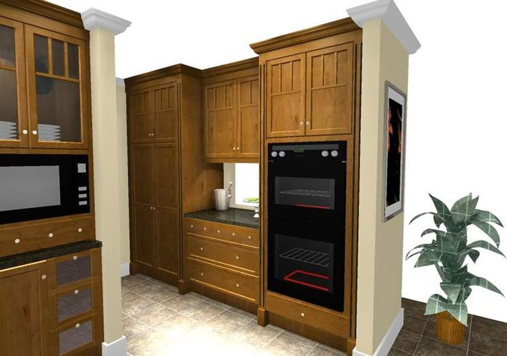 Craftsman style kitchen in cherry wood with wide pilasters surrounding tall cabinets