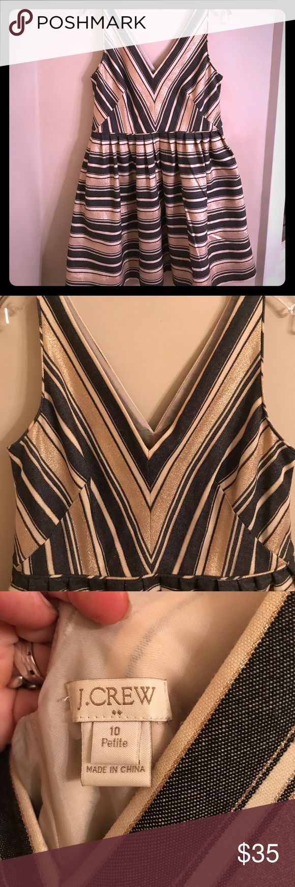 JCrew striped charcoal and gold cocktail dress Excellent condition, worn once to a dance. Alternating wide and thin ribbon weave striped of charcoal and gold. Deep vees in front and back. A stunner. 10 petite, but fits a regular 4-6 with a short waist perfectly. J. Crew Dresses Midi