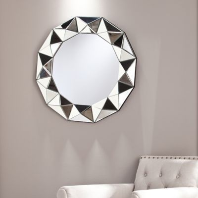 The multifaceted Tresen Decorative Mirror by Southern Enterprises adds unique, angled dimensionality to your interior d�cor. Striking frame design is comprised of triangular mirrored tiles to create stylish pattern and depth in any room.