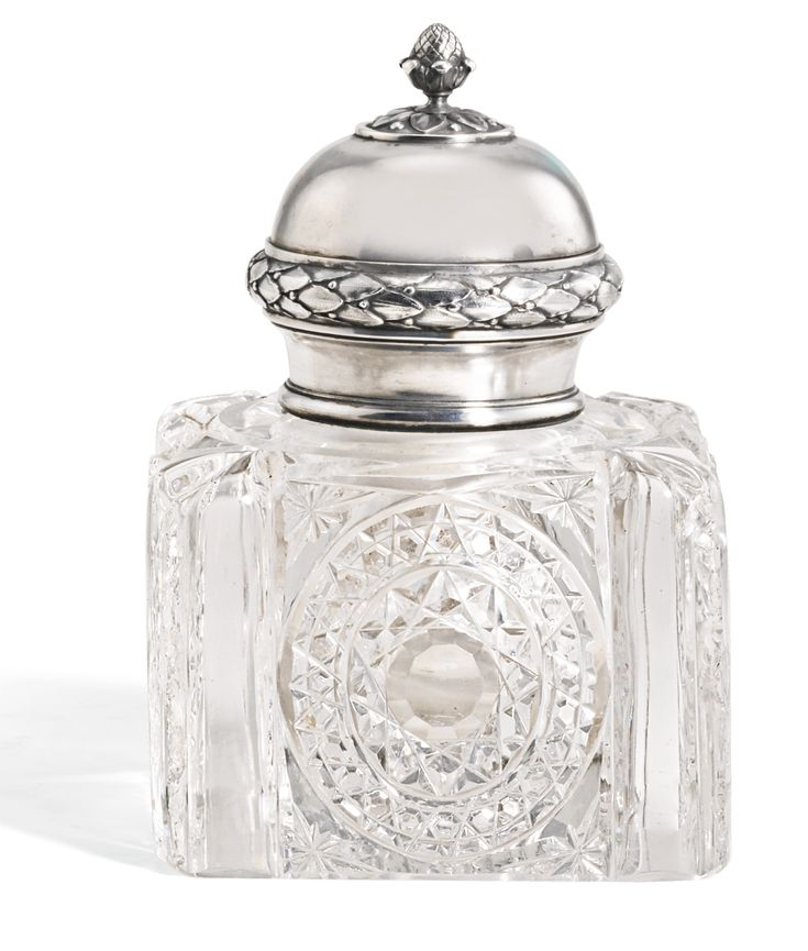 A Fabergé silver and glass inkwell, Moscow, 1908-1917, square, the body cut with faceted ovals, the domed lid above cast with laurel and berry, fir cone finial.