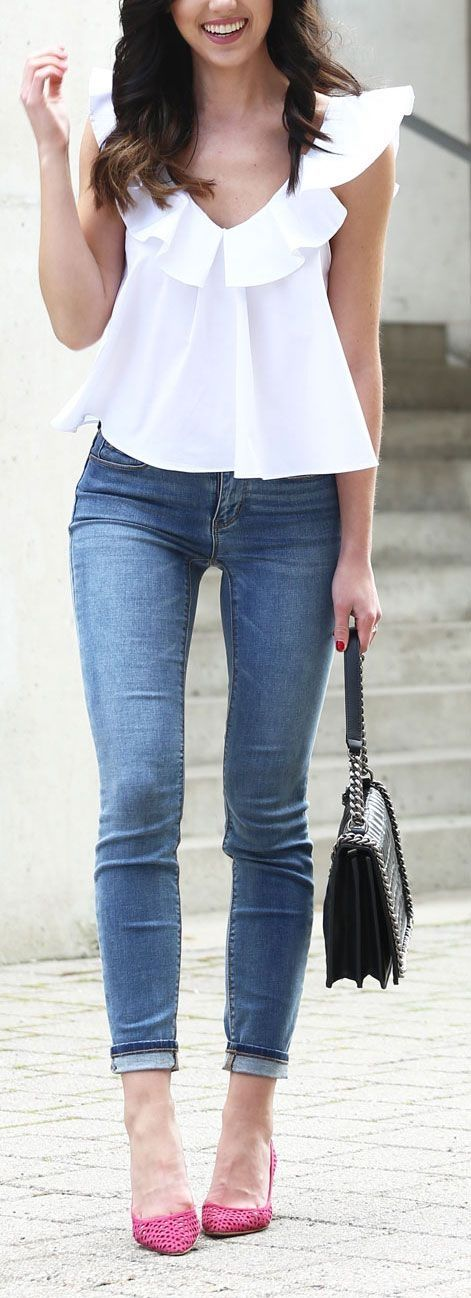 The prettiest white ruffle blouse for spring and summer - with a pop of pink heel pumps / light wash skinny jeans under $100 / affordable Stella McCartney knock off bag