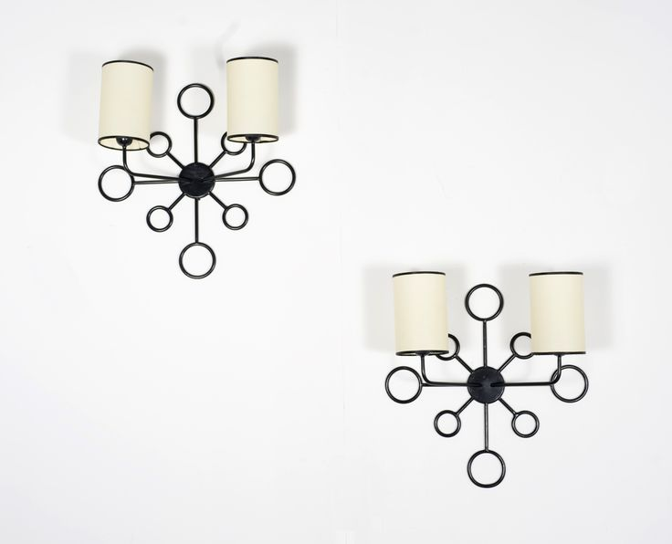 Jean ROYÈRE (1902-1981) Yo-Yo A Wall Sconce, Black Lacquered Metal, the sconce has two fixtures  Editions SA 20.5 x 7 x 20.75 in. - 52 x 18 x 53 cm.