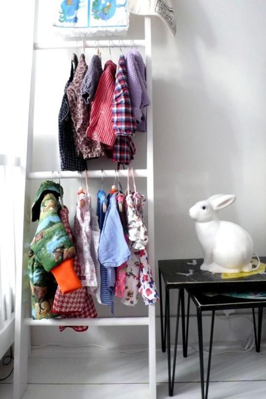 Turn a ladder into a wardrobe.  We like the idea of using a simple ladder to hang up baby clothes. Just think of all that ever-valuable closet space you could free up. Take out every other rung. Add a coat of paint. Figure out a clever way to secure it to the wall.