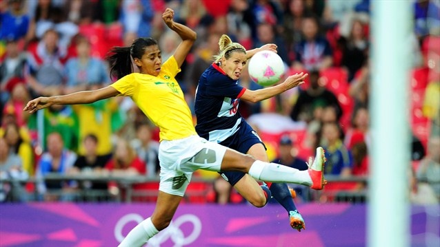 Kelly Smith of Great Britain shoots at goal under pressure from Bruna of Brazil during the women's Football first round match between Great Britain and Brazil on Day 4 of the London 2012 Olympic Games at Wembley Stadium.
