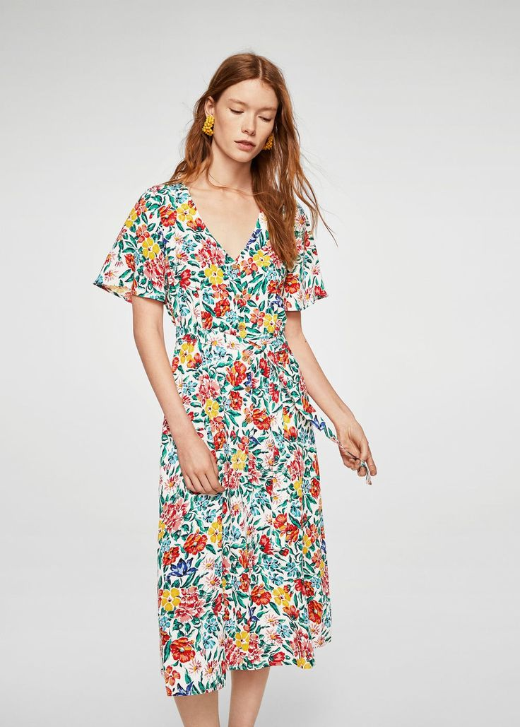 Straight design Flowy fabric Floral print V-neck neckline Short sleeve Fitted waist Belt loops Bow at waist Button front