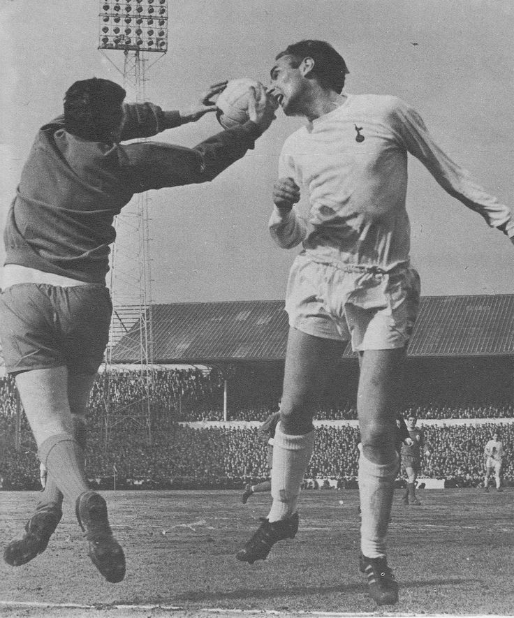 9th March 1968. Liverpool goalkeeper Tommy Lawrence catching the ball just before Tottenham Hotspur striker Alan Gilzean can reach it in an FA Cup 5th round tie, at White Hart Lane.