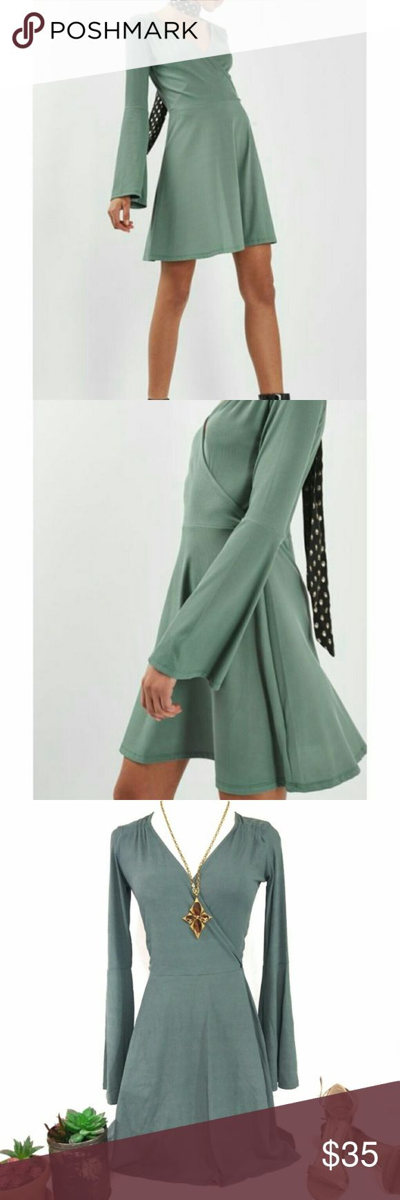 "NWT Topshop Bell Sleeve Surplice Fit Flare Dress NWT. Perfect condition! Stock image reflects true color.   Sizes US 4 & 6 (XS and Small.)   Great for Fall with knee high boots and a scarf, or heels for a night out! Adorable ribbed bell long sleeve dress from TOPSHOP in the color Duck Egg (a pretty shade of green,) with a surplice bust, fitted waist, and flared skirt. Fun and flirty!   - Surplice neck - Long bell sleeves - Shirred shoulders - Rib knit construction - Approx. 34"" & 35"" length…"