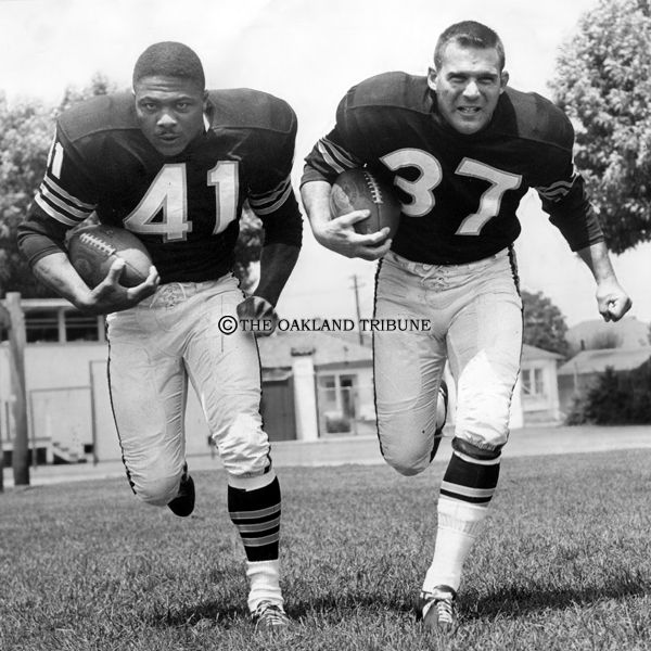 RAIDERS SUNDAY Santa Cruz, CA Circa August 1962 - Oakland Raiders halfback Clem Daniels (left) and fullback Alan Miller on the team's practice field at Santa Cruz High School. 1962 was the first year the Raiders played on Frank Youell Field which would remain their home field until the Coliseum opened in 1966. (Chris Kjobech / Oakland Tribune)