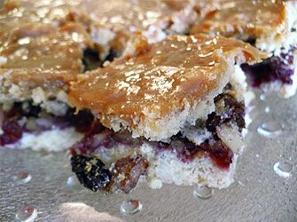 Mazurek decorated with icing, chocolate, krowka type toffee , dried or fresh fruit, almonds, nuts and raisins.