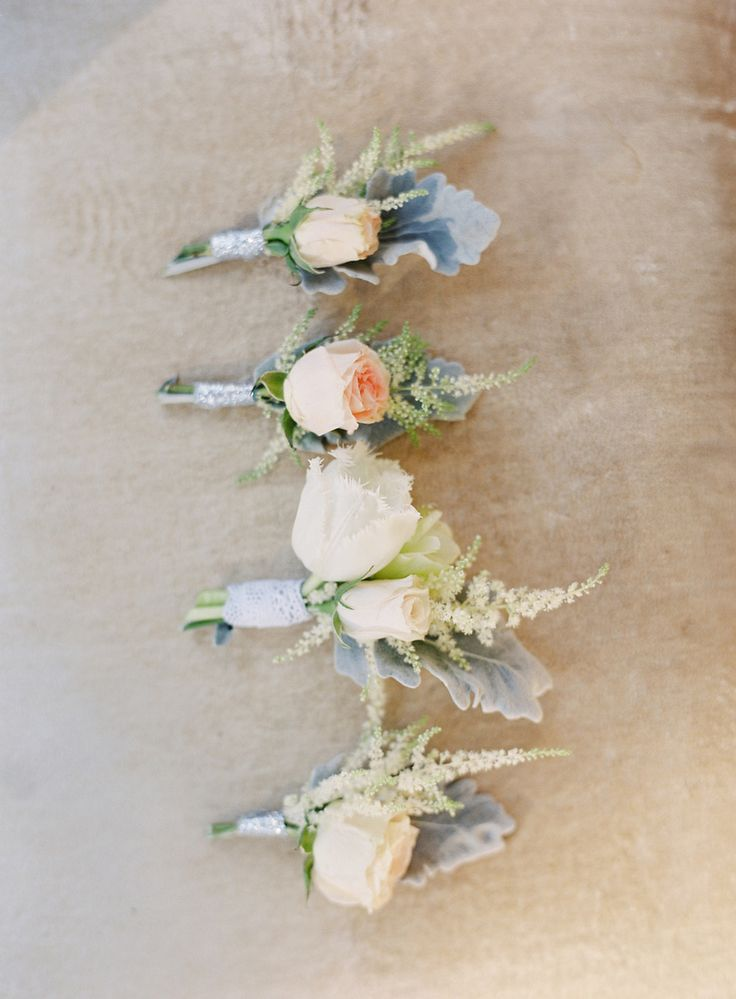 Pretty Soft Rose Boutonnieres with lovely texture.  See the wedding on SMP - http://www.StyleMePretty.com/2014/01/27/rustic-rancho-las-lomas-wedding/ Photography: Elan Klein Photography