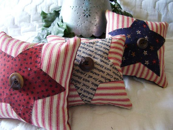 Welcome to my shop and thank you for stopping by. I have made these cute litte pillows by appliquing stars onto stained red pillow ticking fabric . I have used cotton fabrics for the stars for a prim look. They each have a vintage button in the center. They are stuffed with polyfil. These cute pillows can be used to decorate a country , primitive or folk art style home. It would be a great accent tucked into a wreath, bowl fillers, ornies or anywhere for a farmhouse look . They measure about…