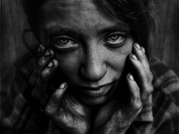 "Lee Jeffries is an accountant who also happens to take harrowing photos. ""My involvement with the homeless started after an encounter with a young girl in London,"" Jeffries told Impose Magazine back in September of 2010. ""She was huddled under a sleeping bag in a doorway in Leicester Square and took offense as I stole a photo from a distance.…"