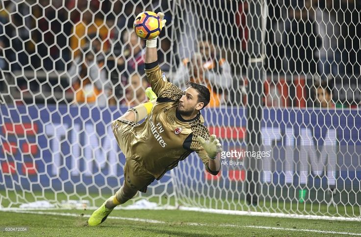 Gianluigi Donnarumma ,Goalkeeper of AC Milan saving the ball from Juventus FC's Penalty during the Supercoppa TIM Doha 2016 match between Juventus FC and AC Milan at the Jassim Bin Hamad Stadium on December 23, 2016 in Doha, Qatar.
