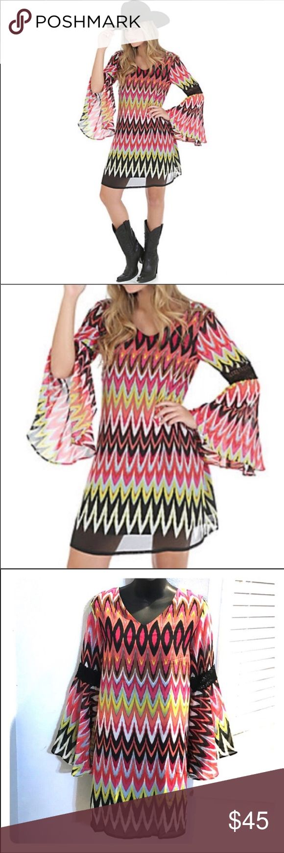 """NWT chevron bell sleeve flowy Wrangler dress M Printed multi color v-neck bell sleeve dress by Wrangler in a size medium. Colors are coral, like green, white, black and blue. New with tags attached. 100% polyester. Dress is lined. Measures approximately 34"""" in length from shoulder to hem and approximately 18.5"""" across from under the arm to the other side making it 37"""" around the chest area. Very roomy, float dress. Have one smaller available also by request. Bundle to save even more on this…"""