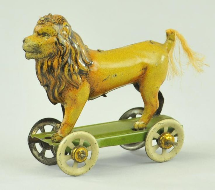 Lion penny toy; Distler, embossed lithographed tin - I wish I could travel back in time with my pennies...