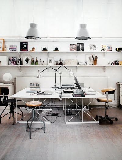 Office. Industrial modern. Big wide desk surfaces. Metal accents. Long horizontal shelving.