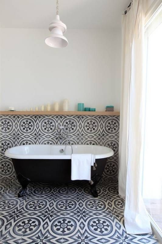 Statement bathroom tiles, curling up from the floor to the wall
