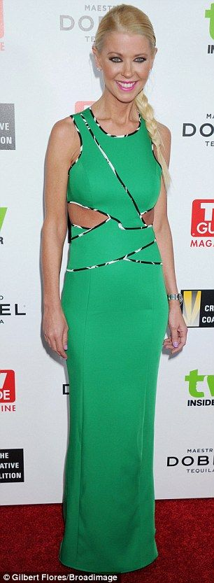 Cut-out queen: Tara Reid showed off her slim figure in a cut-out green gown