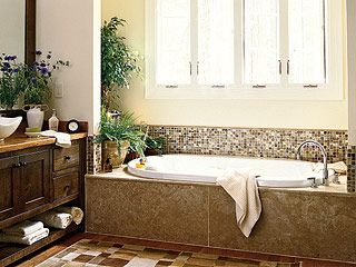 Master bath - love the mini mosaic tiles and the dark wood sinks with open storage.