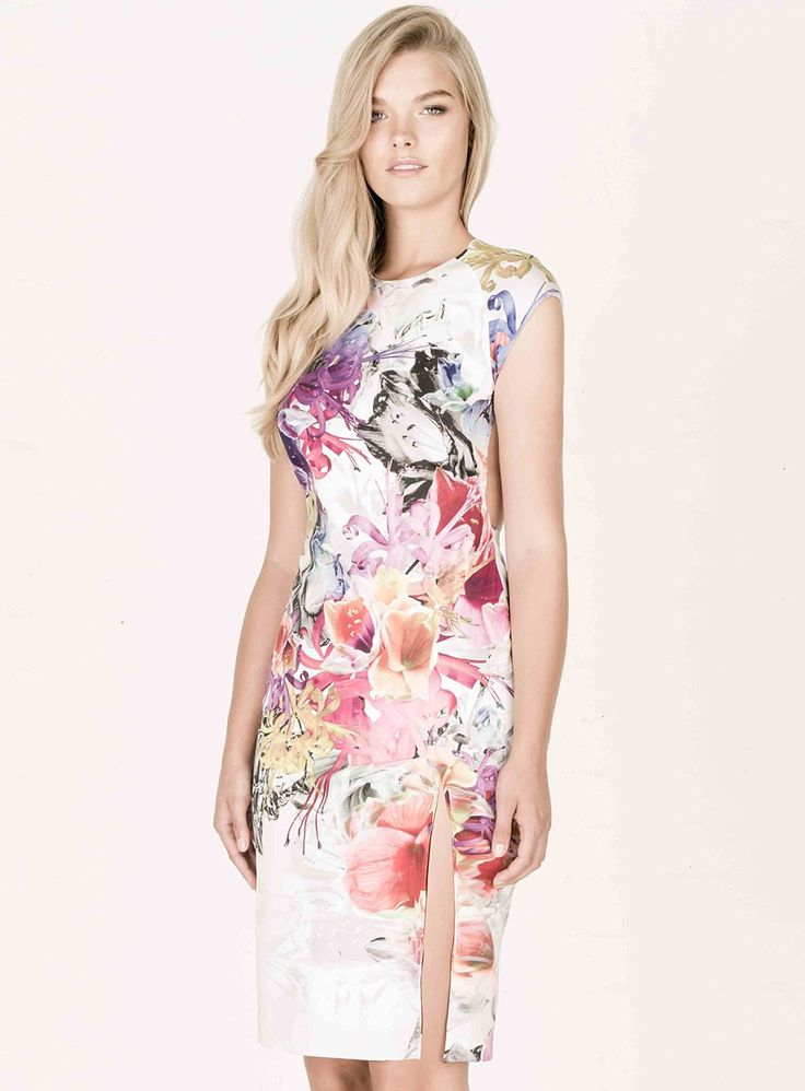 Kuku Bloom Dress. The Bloom Dress by Kuku is a gorgeous floral print dress featuring a thigh high split. /   High neckline / Backless / Concealed back zip / 95% polyester 5% elastane /
