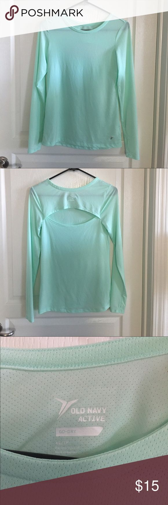 Old Navy Workout Top Size XS Lightweight workout top with cut out in the back and thumbholes. In excellent condition. No rips, tears or stains. No trades or PayPal. Old Navy Tops Tees - Long Sleeve