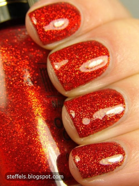 The most fabulous candy apple-esque sparkly red nail polish. #red #nail #polish #manicure