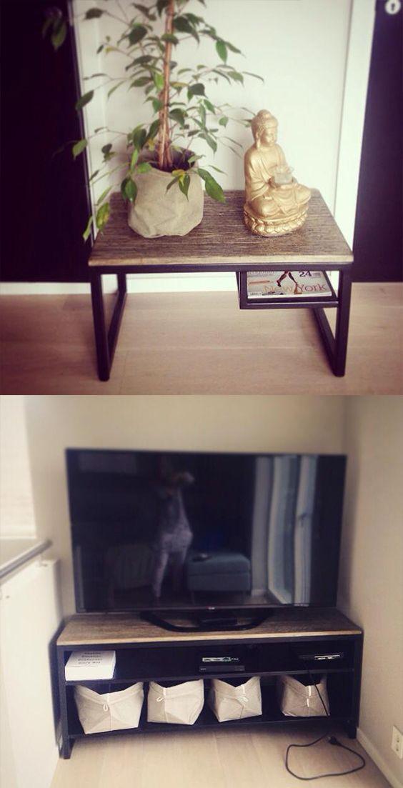 Tv-benk og bord laget av stål lakkert i sort og treplater.
