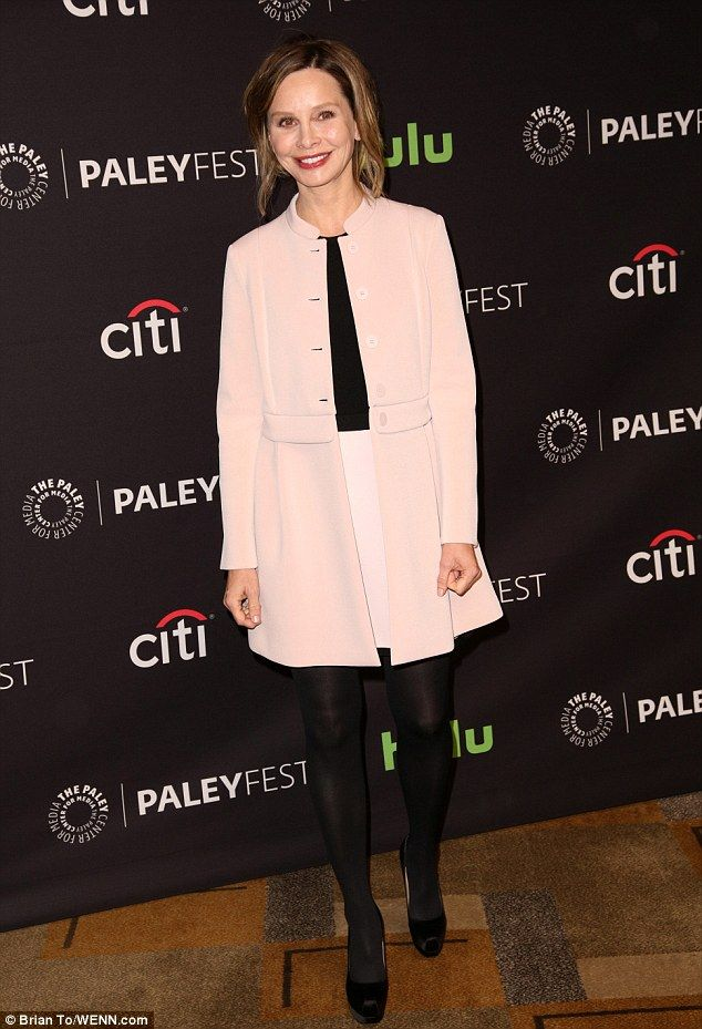 Giving her 5ft5in height a boost: Calista Flockhart looking pretty in a pink coat over a black and pink mini-dress, dark tights, and platform pumps