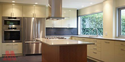 Contemporary kitchen with island and lighting