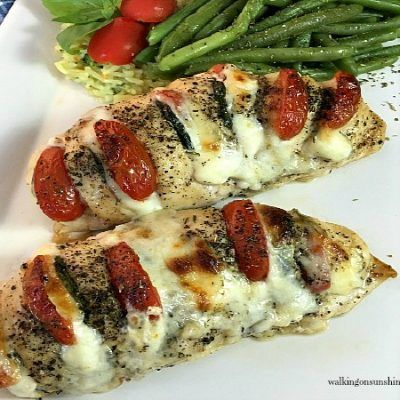 Hasselback Chicken is stuffed with mozzarella, tomato and basil making it a new and delicious way to enjoy chicken for dinner!