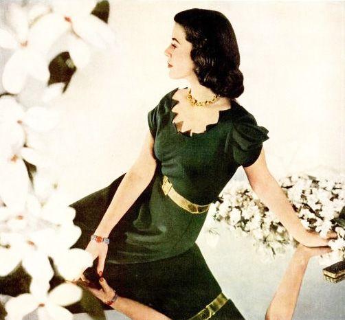 Love the eye-catching neckline.  1940s fashion