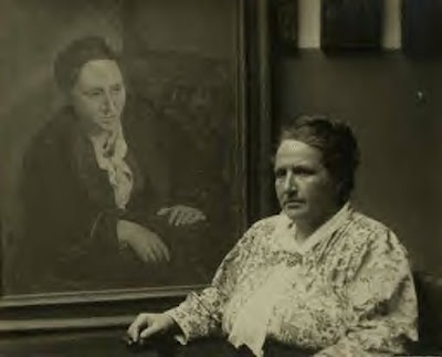 Hemingway's Paris: Gertrude Stein in front of her portrait by Picasso.